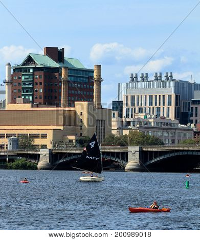 Boston, Massachusetts - August 16, 2017. MIT Sailing boat on Charles River in Boston, Massachusetts with Longfellow Bridge and Boston Skyline on background