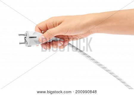 Female hand holds electric cable with plug isolated on a white background.