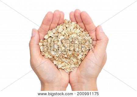 oat in woman's hand isolated on white background.