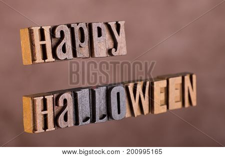 Happy halloween lettering on a brown background