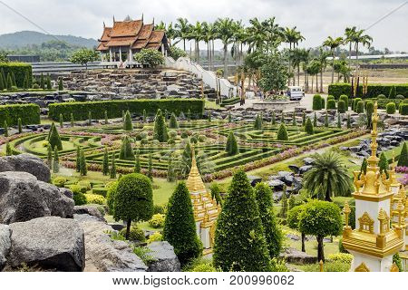THAILAND, PATTAYA, MARCH, 10, 2015 - Landscape of tropical park of Nong Nooch - botanical garden and tourist attraction, wildlife conservation project in Pattaya, Chonburi Province, Thailand.