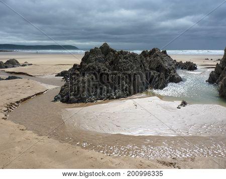 A rocky outcrop on Woolacombe beach, Devon, England.