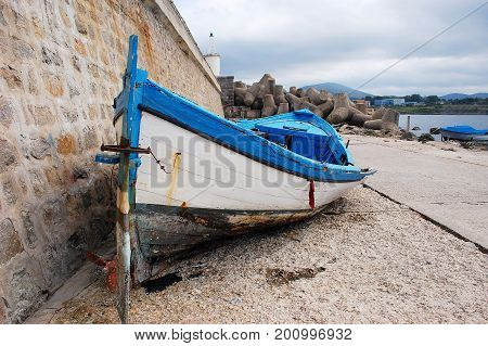 Old abandoned rowboat in Bulgarian port Tsarevo