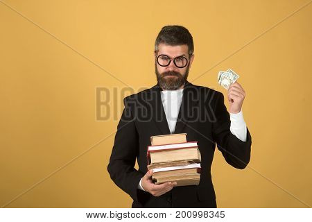 Professor With Strict Face Expression. Teacher Holds Pile Of Books
