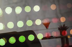 Reflex image of watermelon cocktail welcome drink on colored LED glass wall