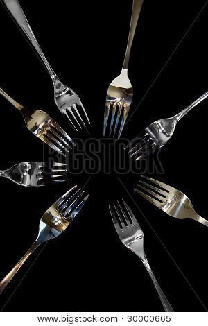 Gold And Silver Forks In A Curcle With Clipping Path