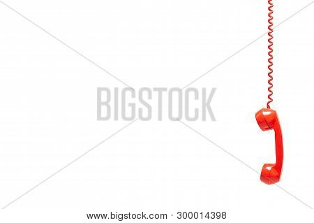 Red Old Telephone Receiver Isolated On White Background With Texting Space, Phone Hanging, Waiting F