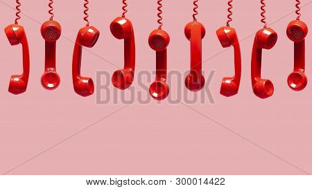 Various Views Of Old Red Telephone Receivers Hanging On Pink Background With Texting Space, Waiting