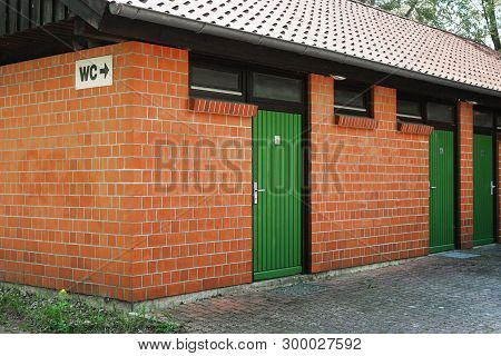 Public Toilet Restroom Building Or Outhouse With Wc Sign In Germany