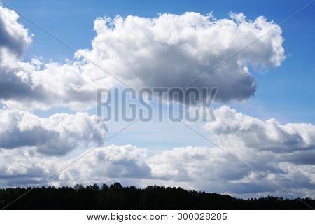 Sky With Dramatic Clouds Over Treetops - Nature Background With Copy Space