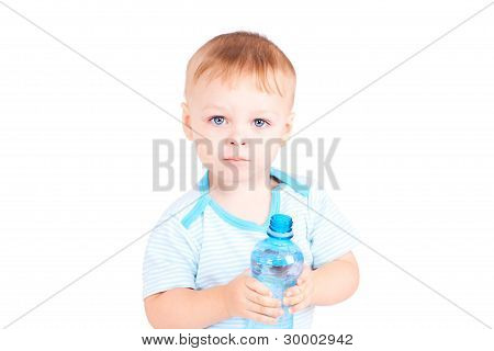 Child Holds A Bottle Of Water