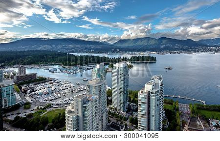 Aerial View Of Vancouver Harbor From Downtown Vancouver And North Vancouver On The Opposite Shore Of