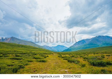 Spectacular View Of Distant Giant Mountains. Footpath Through Valley In Highlands. Hiking Path. Wond