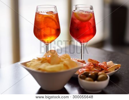 Italian Aperitives/aperitif: Glass Of Cocktail (sparkling Wine With Aperol) And Appetizer Platter On