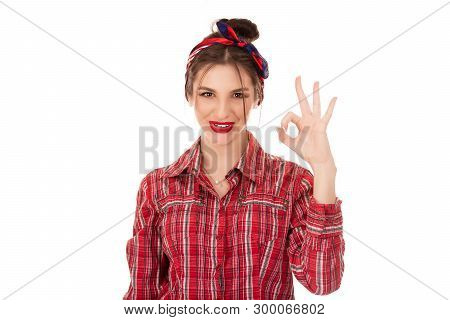 Everything Will Be Alright. Beautiful Young Happy Woman Showing Ok Sign Isolated On Light Green Wall