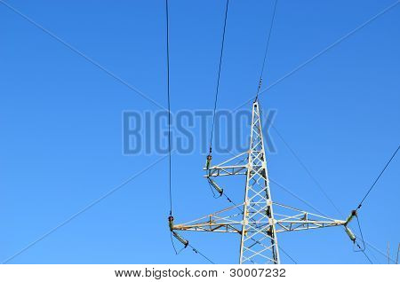 Electricity Wire And Pole In Background Blue Sky