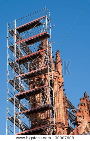 Church Tower Renovation Against A Blue Sky