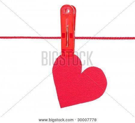 Red heart on the clothespin