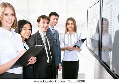 Business people is working together with the screen