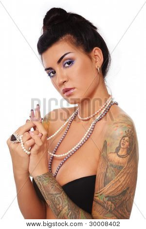 Young beautiful sexy tanned brunette with gorgeous tattoo on her arms, over white background
