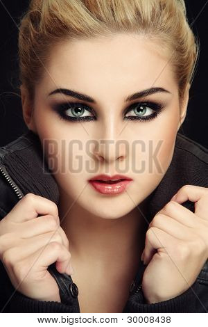 Close-up portrait of young sexy blond girl with trendy make-up