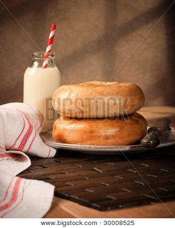 Bagels with milk in vintage style place setting