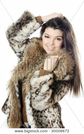 The beautiful girl in a fur hood
