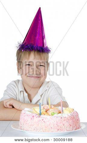 Boy in a cap with a pie
