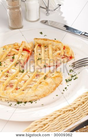 tasty quiche with cheese and vegetables