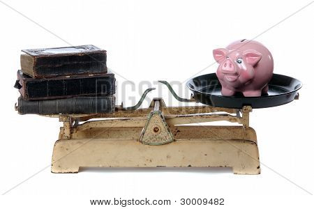 Books And Piggy Bank On Scale