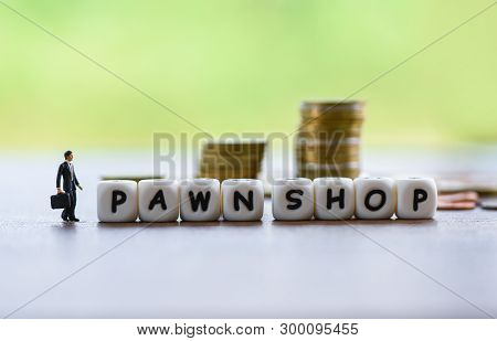 Pawn Shop Concept / Businessman Financial Borrow Loan Pawn For Cash With Coin Background