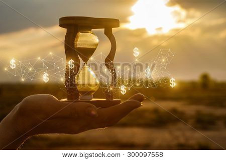 The Concept Of Time And The New Financial Ideas. Hourglass In Hand With And Financial Structure At S