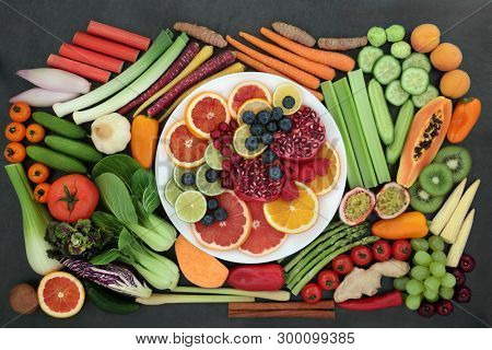 Health food for healthy eating for vegans & vegetarians with with fresh fruit, vegetables, herbs ad spices with super foods high in antioxidants, smart carbs, anthocyanins, vitamins and dietary fibre.