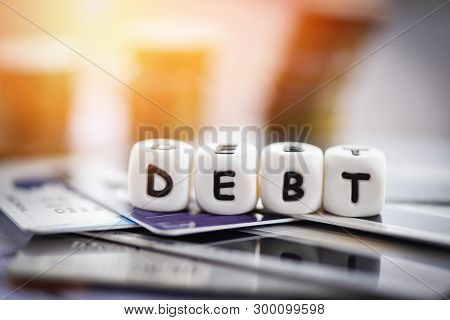Debt Credit Card And Money Coin Stack / Increased Liabilities From Exemption Debt Consolidation Conc