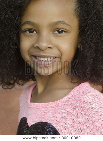 Beautiful little girl with curly hair and pretty