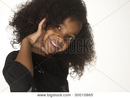 Adorable smiling playful little girl isolated against white background