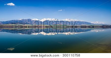Crystal Reflection Of West And High Tatras Mountains In Water Resevoir Liptovska Mara, Slovakia