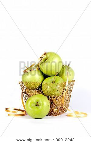 Green apples In A Gold Basket