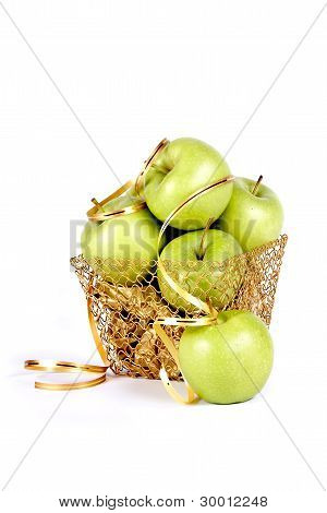 Green fruit In A Gold Basket