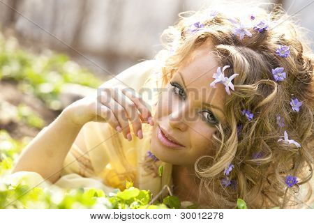 Young girl and spring flowers in her hair