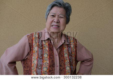 portrait of furious elder woman. enraged elderly female. angry asian senior poster
