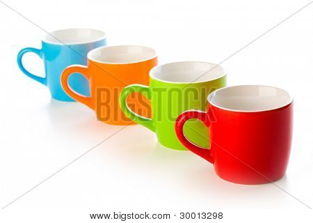 colorful ceramic mugs on white background