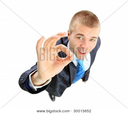 Young and beautiful businessman making ok sign . Top view