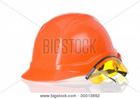 construction helmet and glass tool isolated on white background