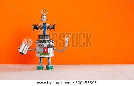 Fantastic Robot Handyman With Light Bulb. Fixing Maintenaance Concept. Creative Design Robotic Toy,