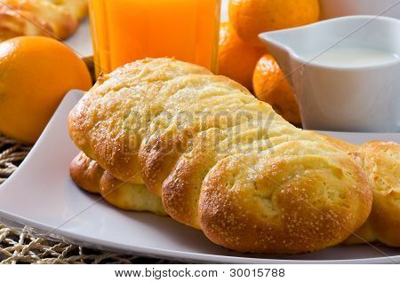 Breakfast with croissants in white dish.