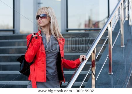 Woman In Red Jacket Standing On The Shop