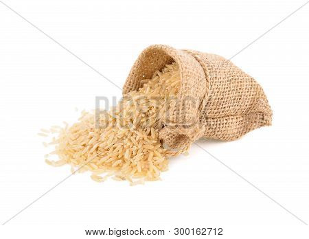 Organic Brown Jasmine Rice In Sack And On White Background