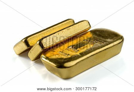 Three Cast Gold Bars, The Typical Form Of Bullion Gold Bullion. Isolated On A White Background. Sele