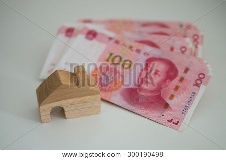 Banknote Currency Chinese Yuan (cny Or Rmb) And Wooden House Block For Property And Land Business Co